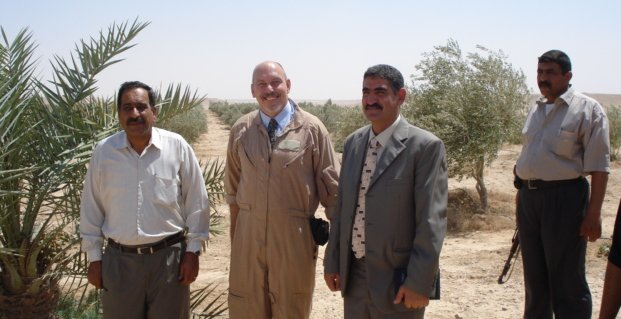 John Matel at desert plantation in Iraq