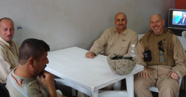 John Matel with Iraqi patrons at a local restaurant in Hadithah, Iraq