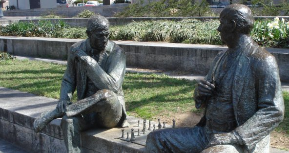 Statue of chess players in John Marshall Park on March 31, 2009
