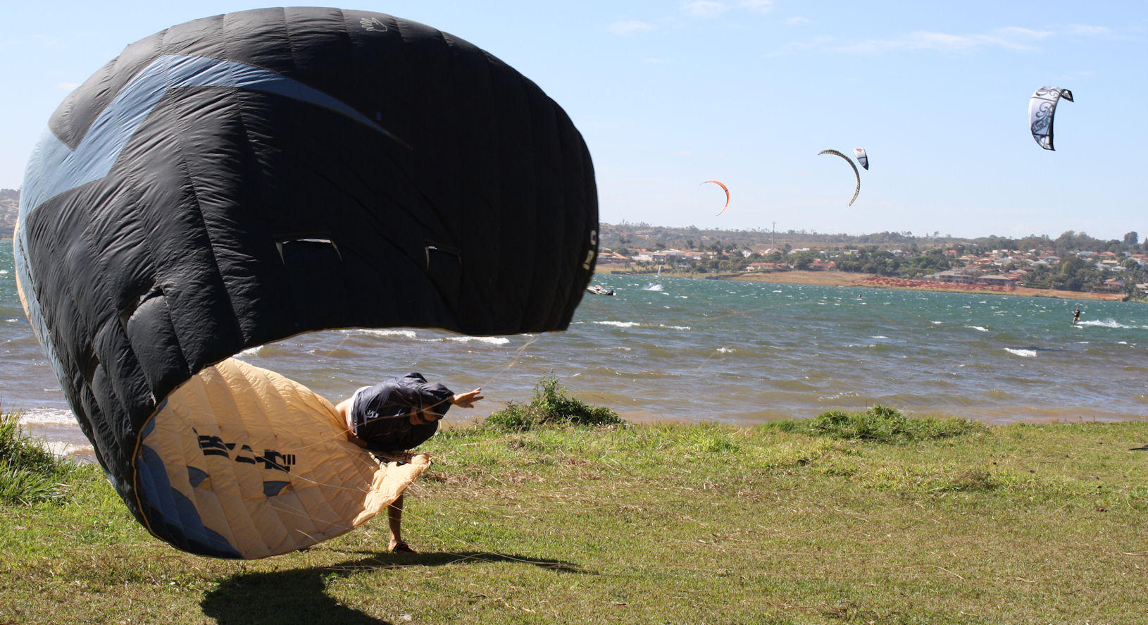 Wind surfer in Brasilia sorting out his equipment